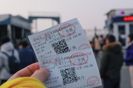 person holding tickets
